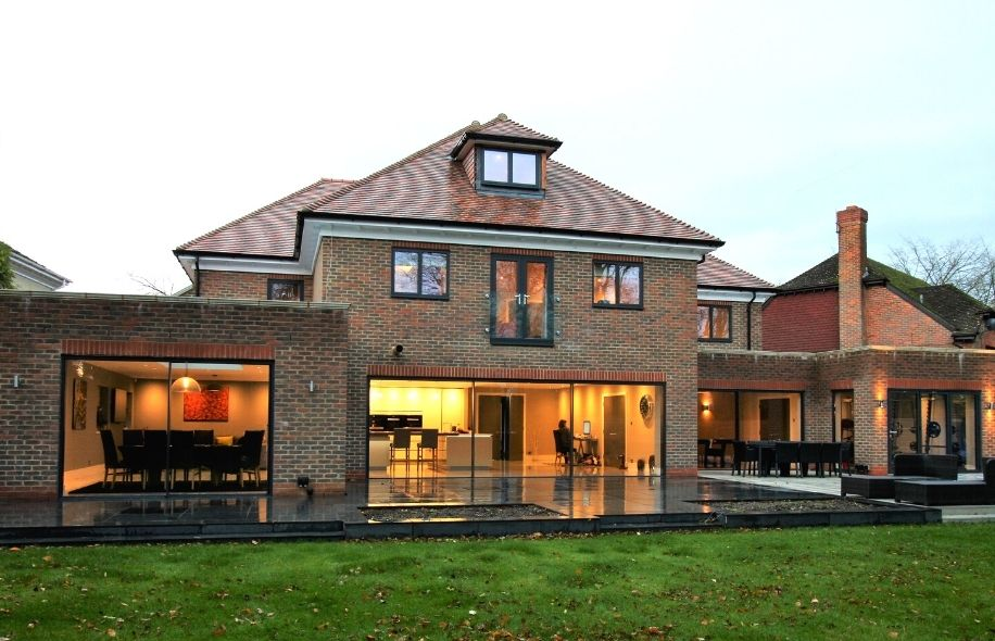 luxury new build home with a modern juliet balcony - slim sliding glass doors and aluminium casement window from sieger