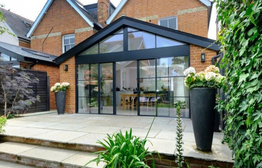 modern extension with gable end windows and steel look sieger slim sliding doors