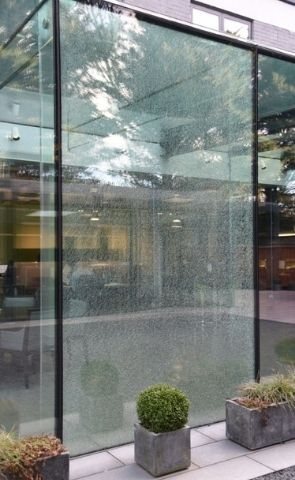 shattered glass held together by a security interlayer