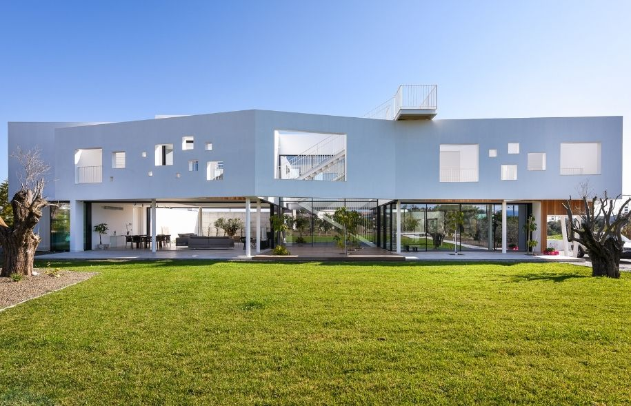 luxury modern villa in greece with cycladic architecture and sliding glass doors