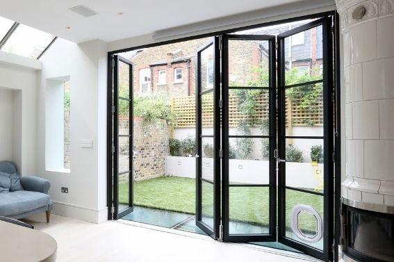 sieger legacy steel look aluminium bifold door with glazing bars