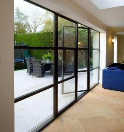 steel look casement patio doors open with outdoor seating area