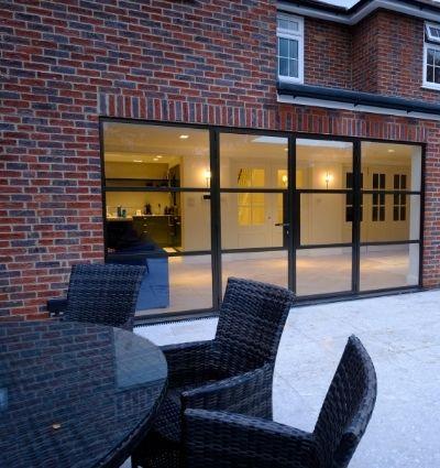 steel look casement patio doors with outdoor seating area