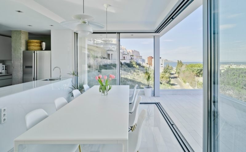 Glazing such as slim sliding doors with a 20mm sightline and frameless glass balustrades are perfect for this type of project, where maximising natural light and having panoramic uninterrupted views are the main priorities. By using frameless glass balustrades on the external balcony there is no obstruction of natural light or views as there is a clear path through the doors and balustrade, both of which have excellent levels of clarity. Amazing views deserve to be appreciated at all times. Materials in this build were carefully selected to ensure the most was made of the stunning views and to give the property a peaceful and serene ambiance.
