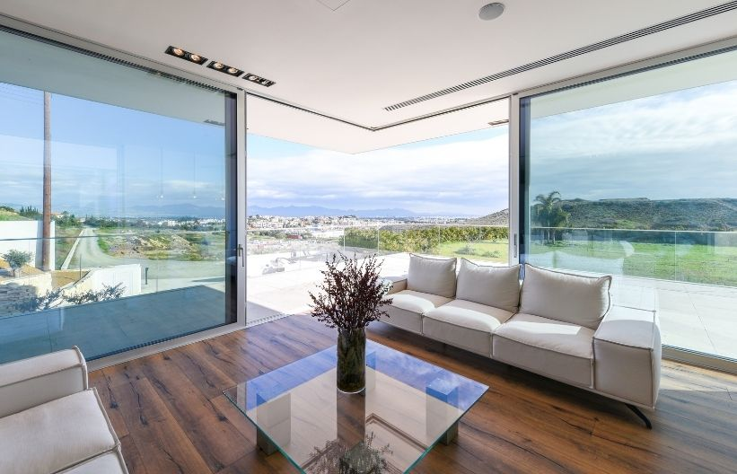luxury holiday villa with slim sliding glass doors in a corner configuration