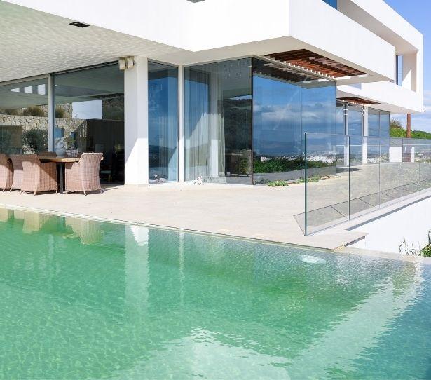 luxury modern villa house design - sliding glass doors and frameless glass balustrade