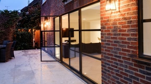 Sieger legacy casement door with sidelights and industrial style casement windows