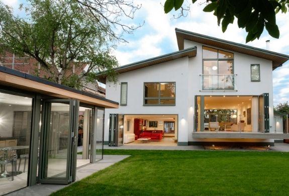 a full glazing package from sieger including grey framed aluminium bifold doors - casement windows - juliet balcony
