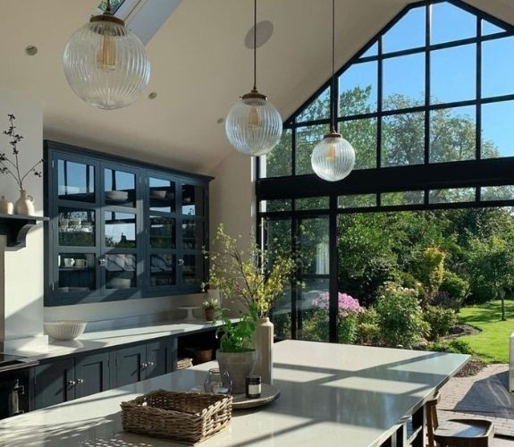aluminium steel look glazing with sliding patio doors and gable end windows with glazing bars