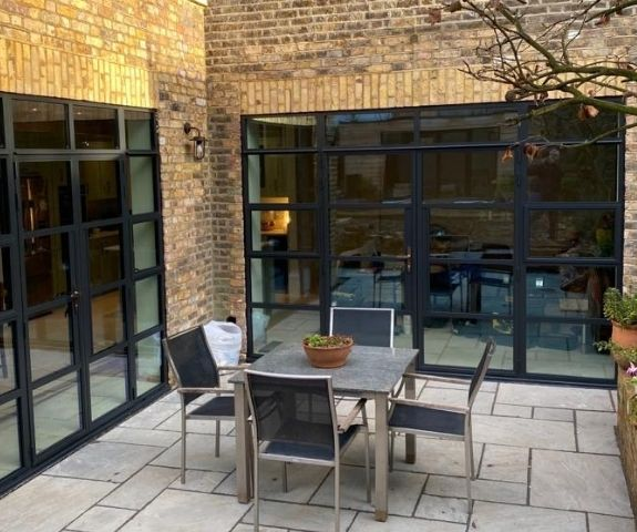 black framed sieger legacy steel look glazing systems in a home renovation