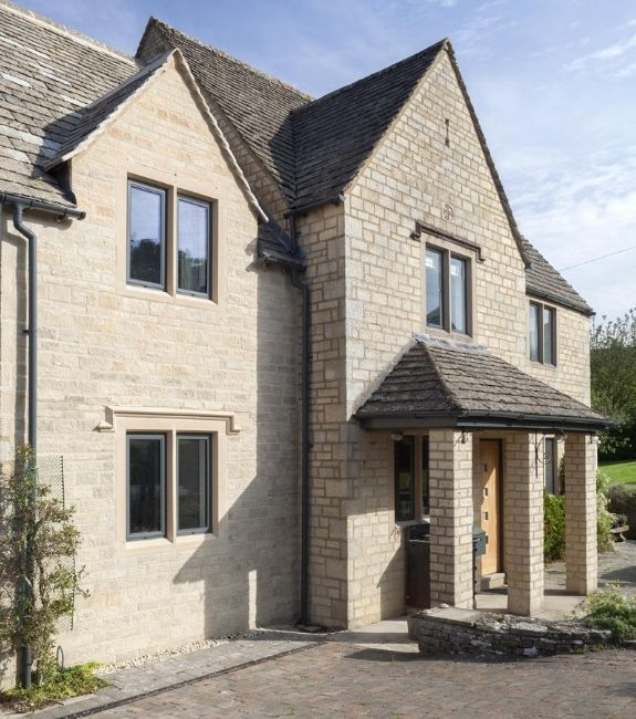 sieger legacy tilt and turn aluminium windows with grey frames on a traditional English country home