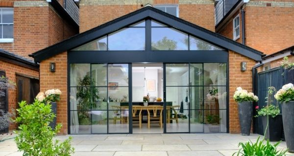 slim sliding glass doors with glazing bars for an industrial style steel look aesthetic