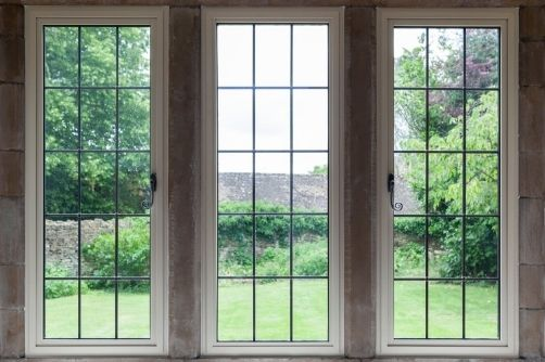 three tilt and turn windows with monkey tail handles and applied glazing bars