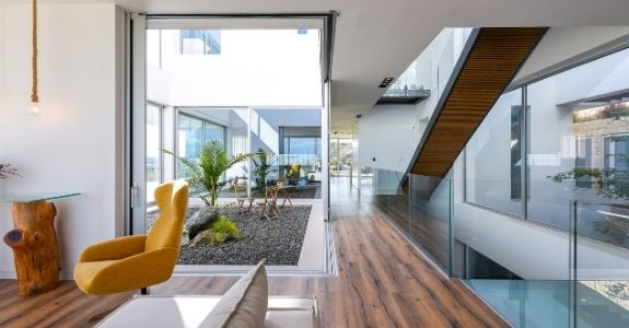 biophilic design incorporated into a luxury holiday villa with internal courtyard with plants and corner opening slim sliding glass doors