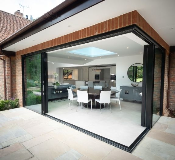 corner opening slim sliding glass doors on a contemporary home extension in Buckinghamshire