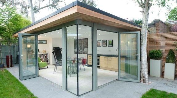 luxury garden room with grey framed aluminium bifold doors