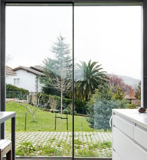 minimally framed aluminium two pane sliding door with ultra slim sightlines offering a clear uninterrupted view of the outdoors