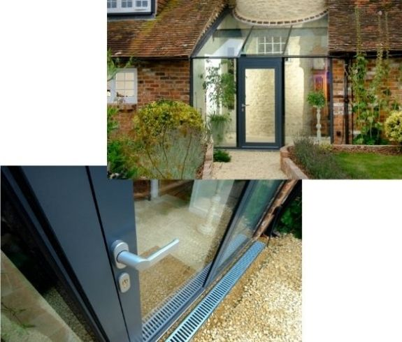 schuco aluminium casement door and Invisio structural glazing including glass roof with a lever handle and euro cylinder key lock