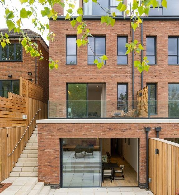 sieger aluminium casement windows and slim sliding glass doors on luxury four storey new build home