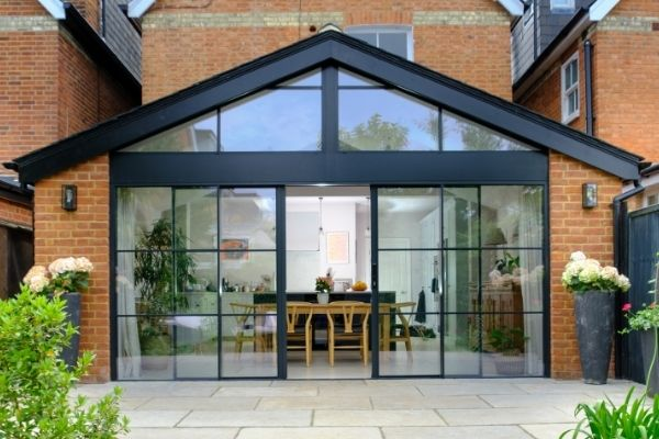 sieger slim sliding doors with applied glazing bars for a steel look aesthetic and gable end windows