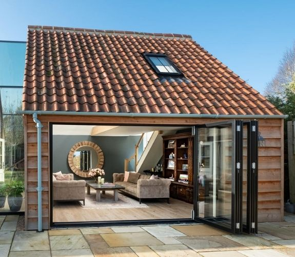 traditional style English countryside home with large bifolding doors with aluminium frames from sieger
