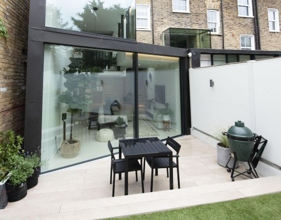 two pane aluminium sliding glass door in a contemporary double height extension on a London townhouse
