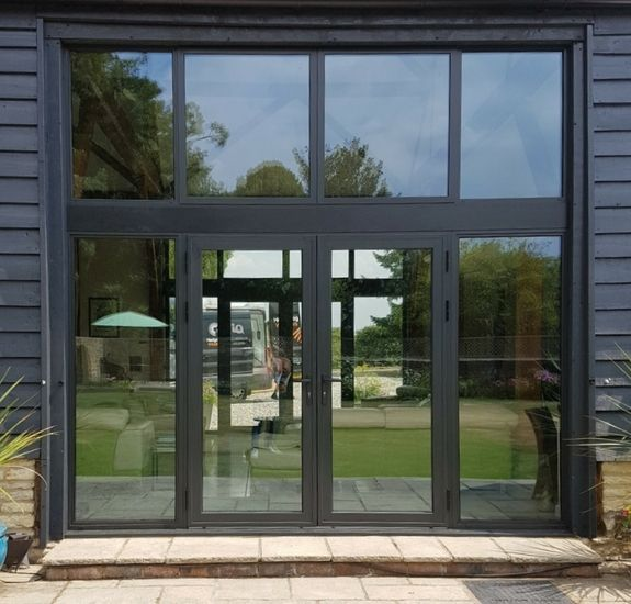 aluminium French casement doors with fixed window sidelights