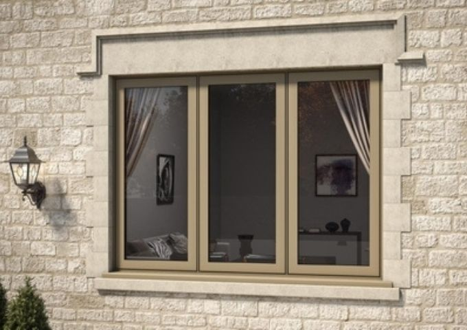 gold framed three pane aluminium casement window with flush design