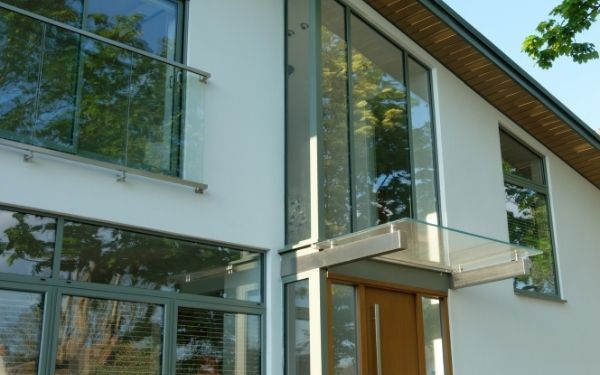 green window frames and grey framed windows and doors for a contemporary glazing style on a new build home