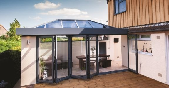 Roof lantern and aluminium bifolding patio doors use to maximise natural light in this home