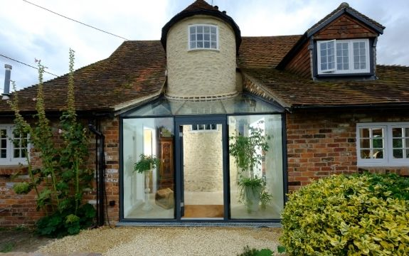 modern glass extension on a period property in the English countryside