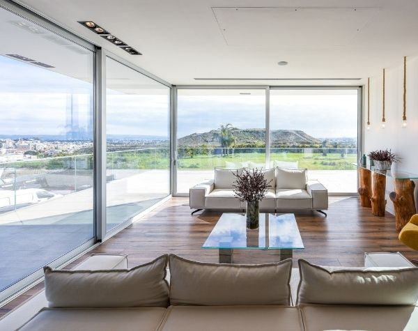 open corner sieger slim sliding glass doors in a luxury Greek villa