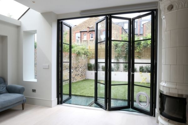 sieger legacy bifold door with applied glazing bars for an industrial style glazing system