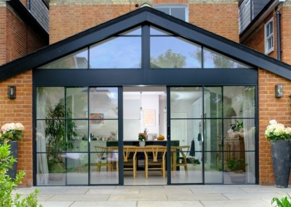 sieger slim sliding doors with applied glazing bars and dummy spacer bars on the doors and gable end window