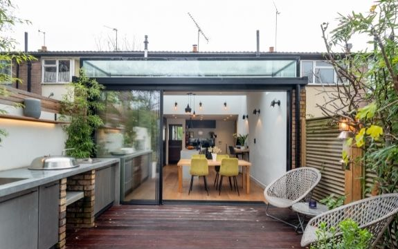 small glass extension using a slim sliding glass door and a box rooflight