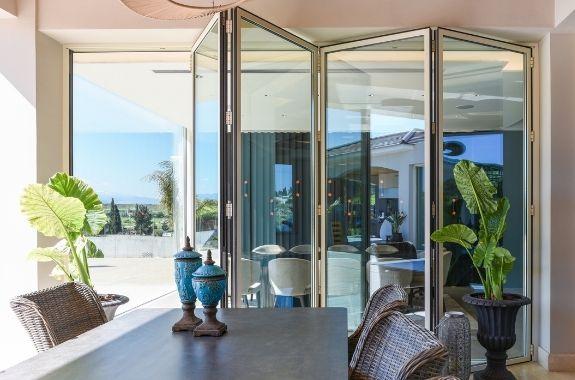 the slimmest aluminium bifold door used in a modern holiday villa design