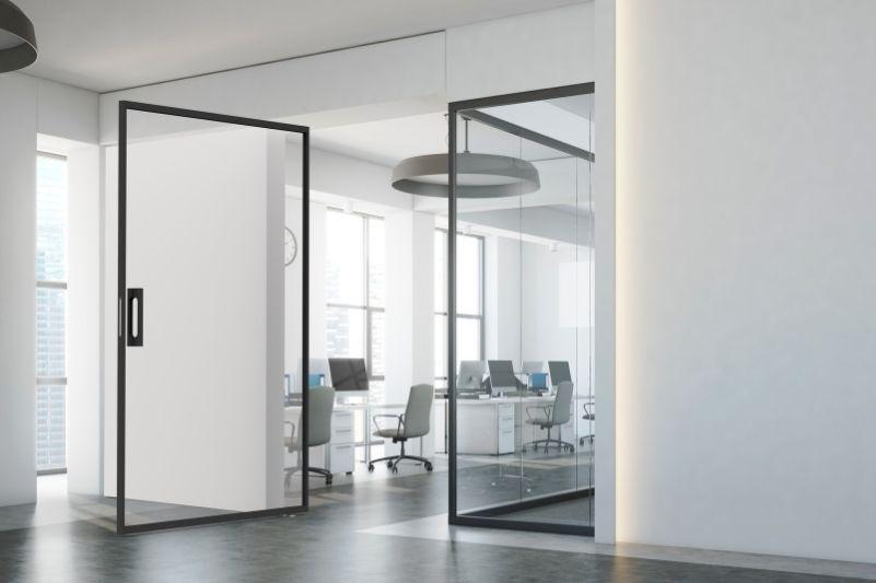 MIRO Pivot internal glass pivot door in a modern office space